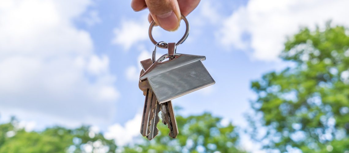 real-estate-agent-holding-a-house-shape-keychain_t20_XQpm4b